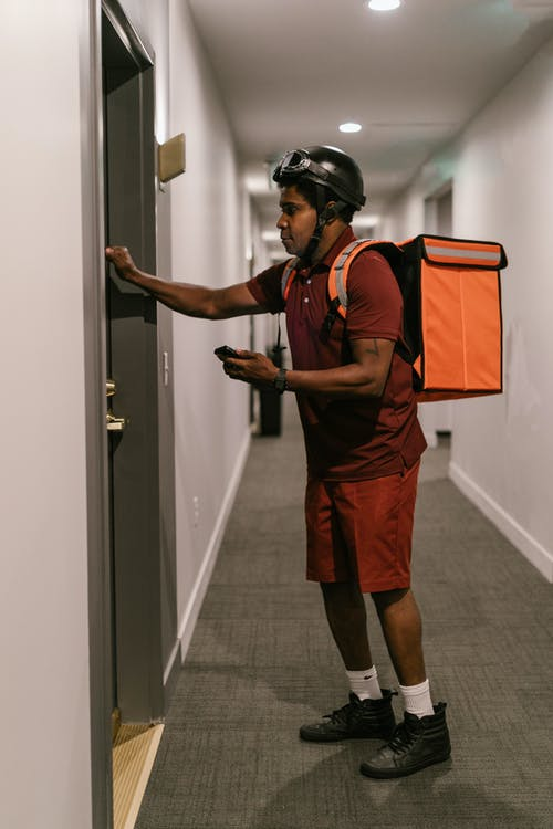 A Deliveryman Knocking on the Door