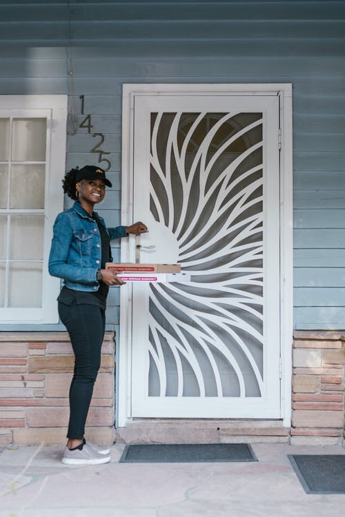 A Deliverywoman Knocking on the Front Door