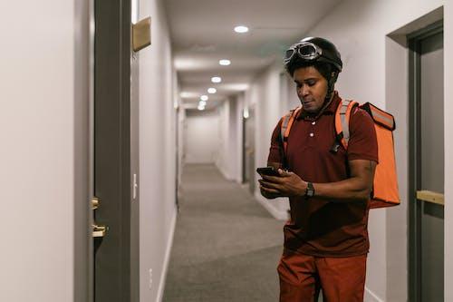A Deliveryman in a Hallway