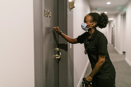 A Deliverywoman Knocking on the Door