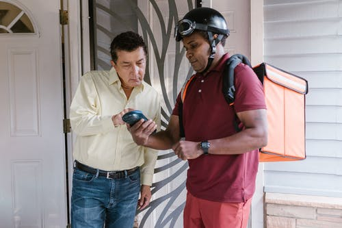 A Deliveryman in the Porch with the Recipient