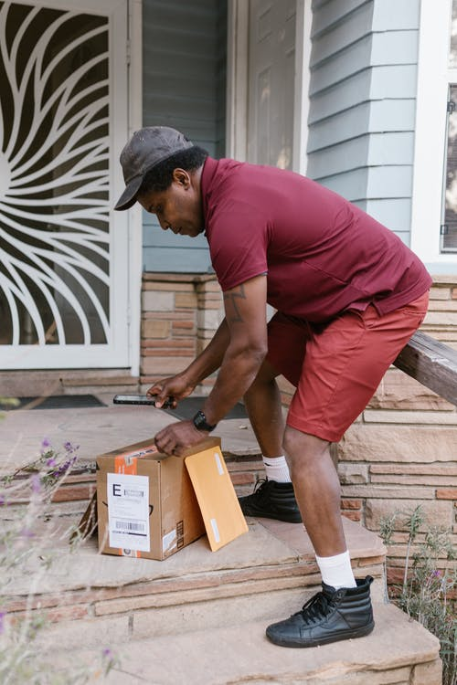 Deliveryman Scanning Barcode from a Parcel