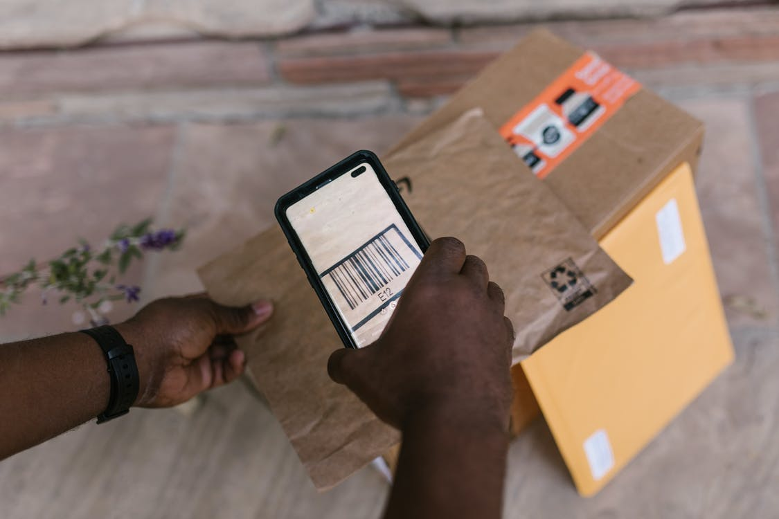 A Deliveryman Scanning the Barcode