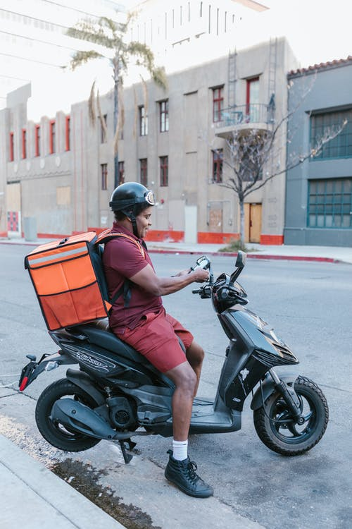 A Deliveryman on a Scooter