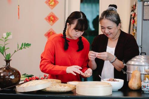 Безкоштовне стокове фото на тему «dim sum, азіатська жінка, азіатська їжа»
