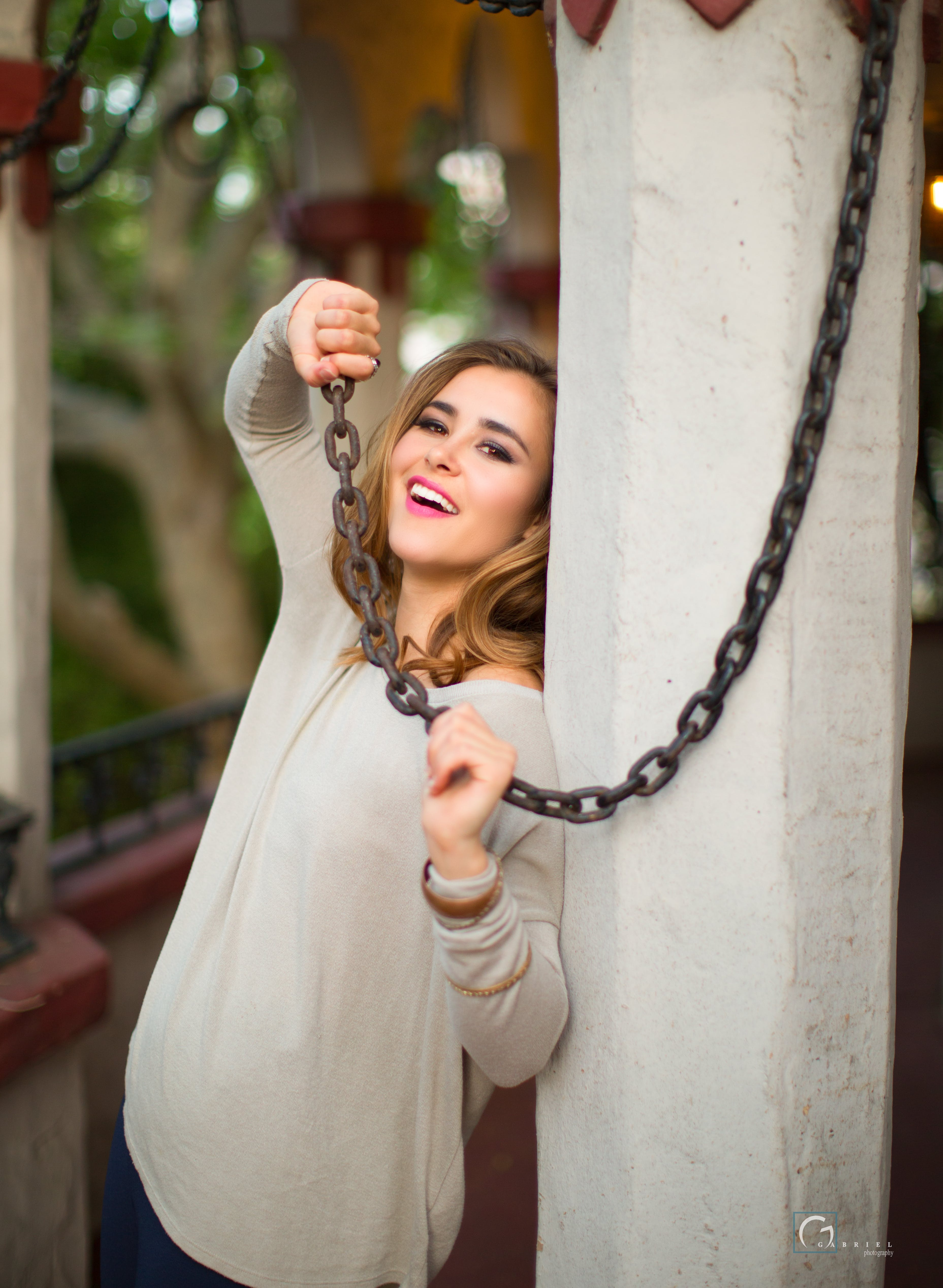 Woman Leaning on Wall While Holding a Chain