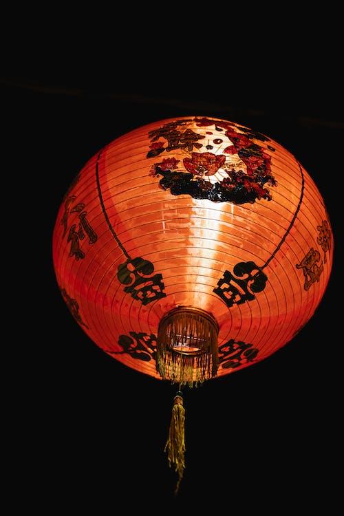 Bright lantern burning on dark sky