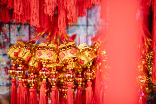 Collection of red and golden Chinese hanging decorations with hieroglyphs for New Year celebration