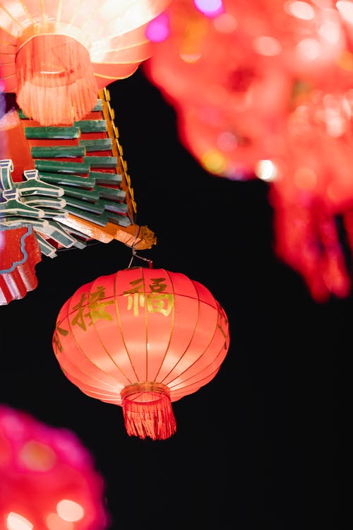 Low angle of traditional Chinese lanterns for traditional festival hanging against night sky