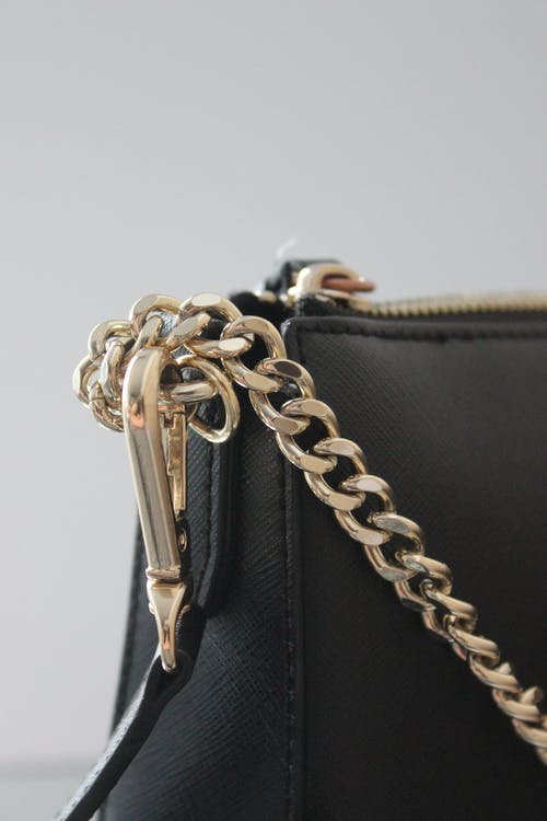 A Black Bag with Gold Chain