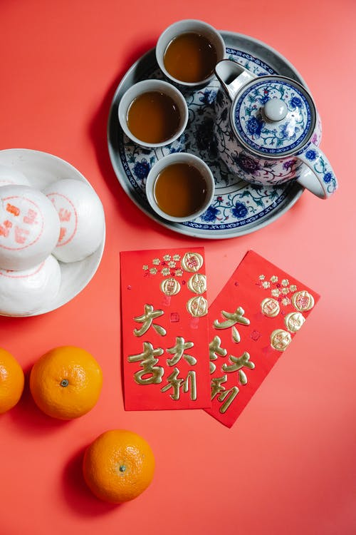 Snacks and Red Envelopes on a Red Background