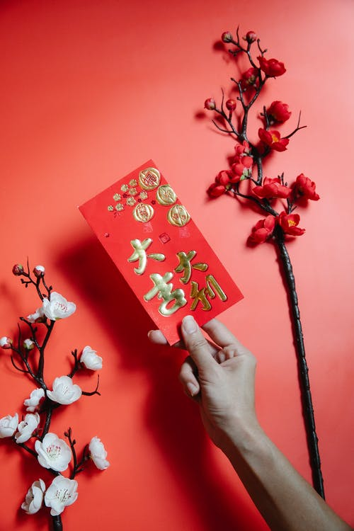 A Person Holding a Red Envelope