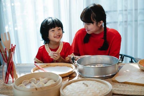 Siblings Learning How to Make Dumplings