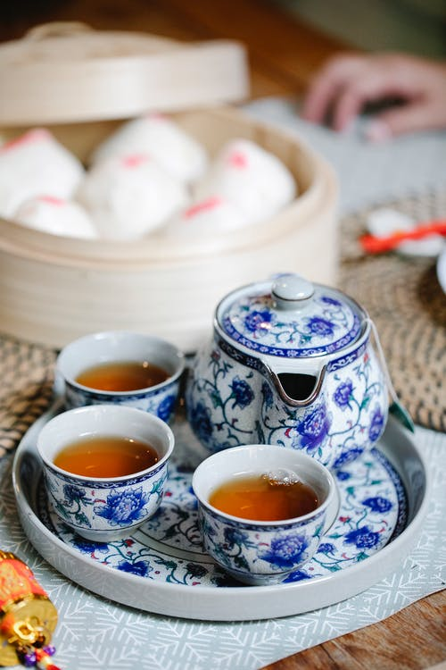 Traditional tea set and Chinese baozi served on table