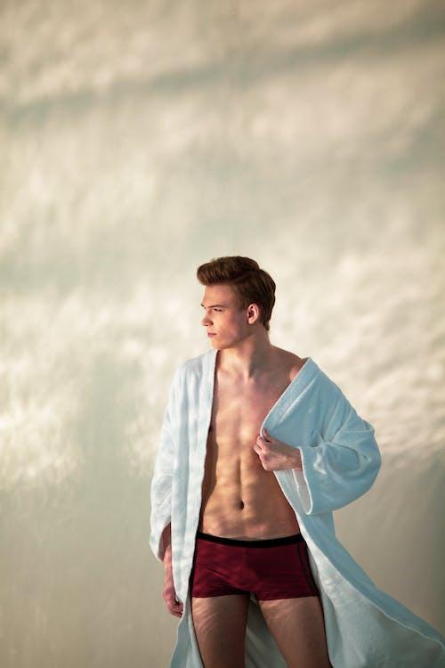 A Man in His Underwear and Bathrobe