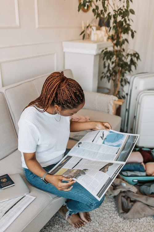 A Woman Reading a Magazine