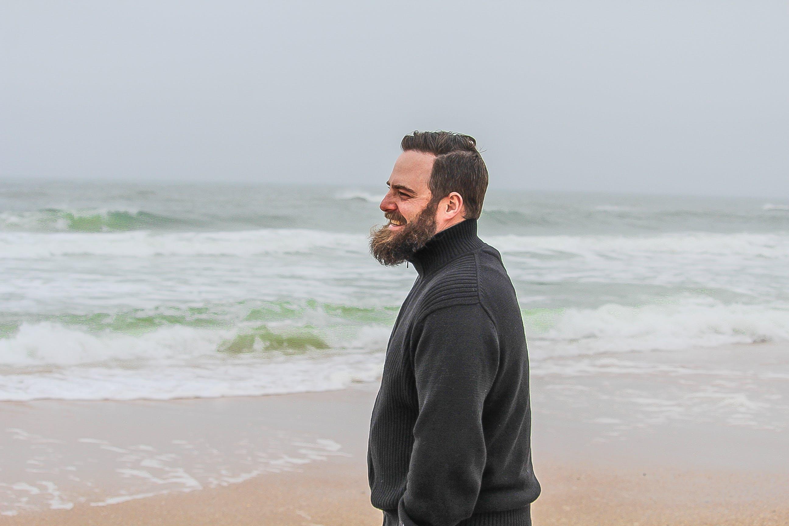 Man in Black Turtle-neck Jacket Standing on Shore