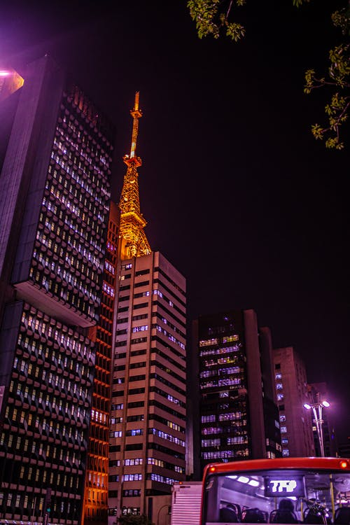 Gold and Black Tower during Night Time