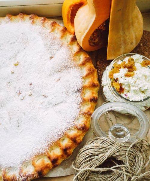 White and Brown Pie on Brown Wooden Tray