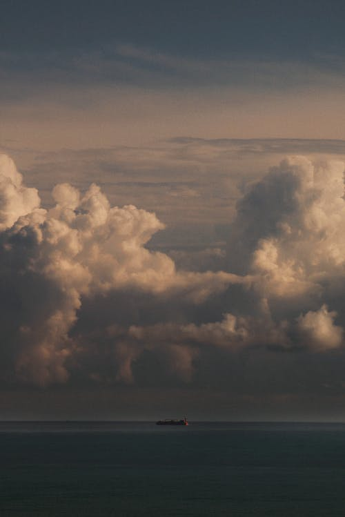 Amazing sunset with fluffy clouds over sea