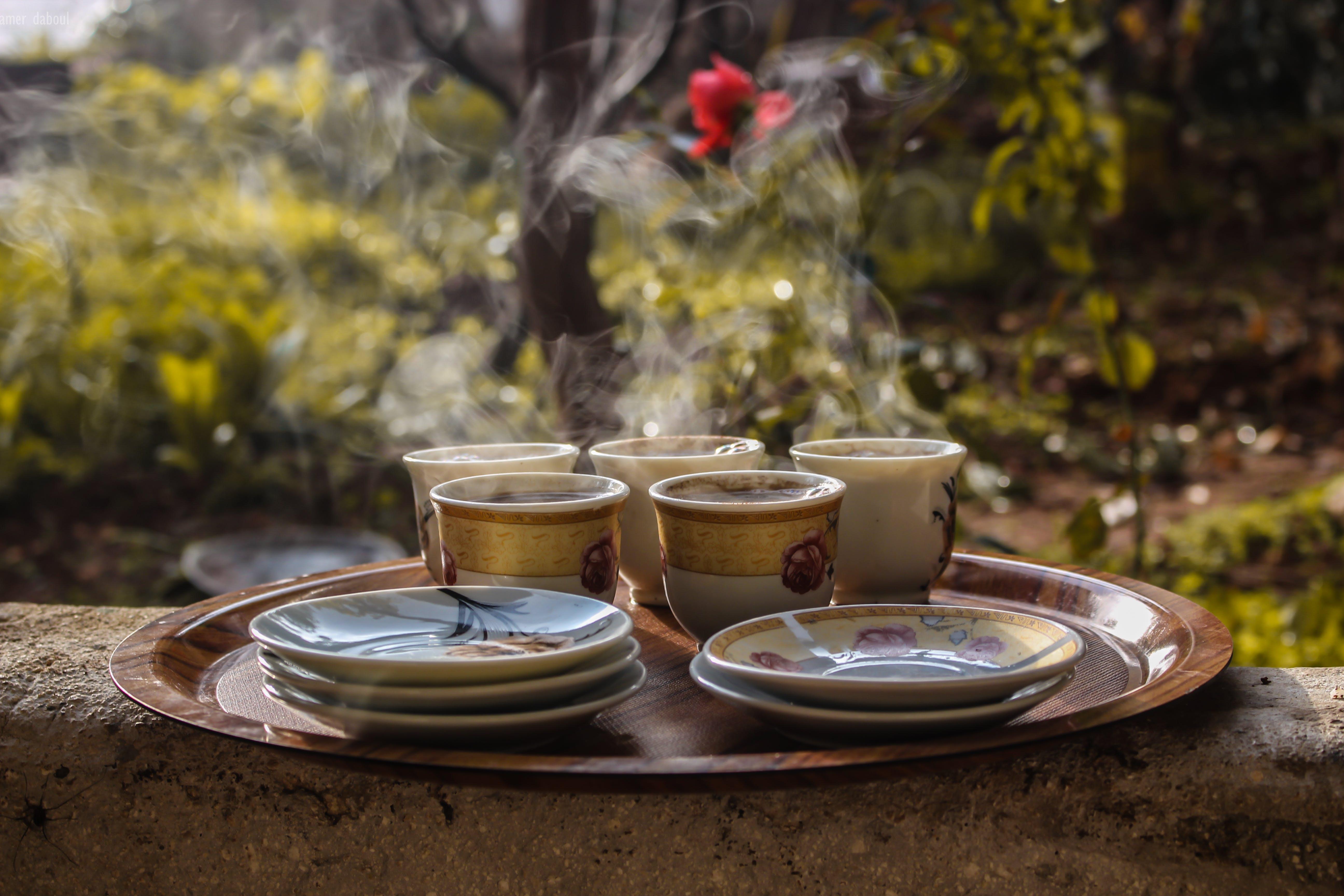 Brown Ceramic Teacups Beside Saucers on Brown Serving Plate