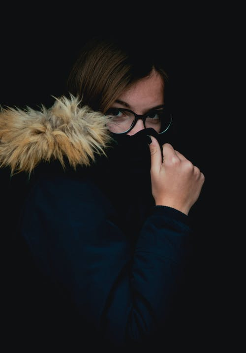 Free stock photo of dark, girl, hiding, jacket