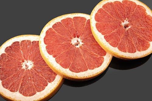 A Close-Up Shot of Slices of Grapefruit
