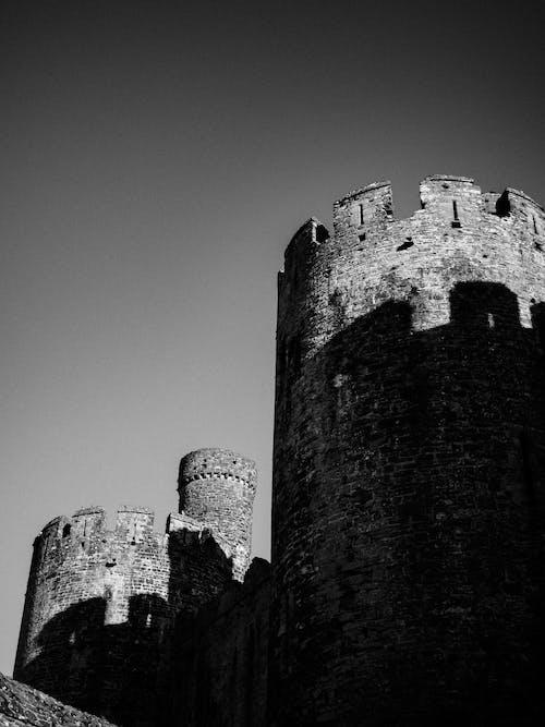 Grayscale Photo of Concrete Castle