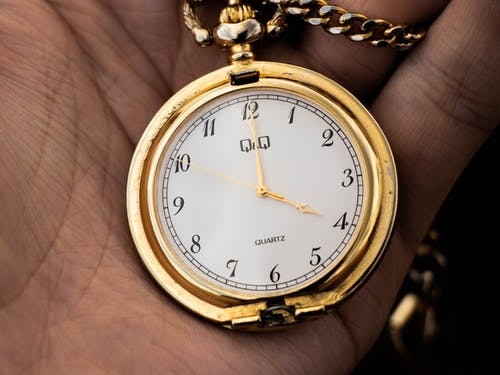 A Gold and White Analog Watch