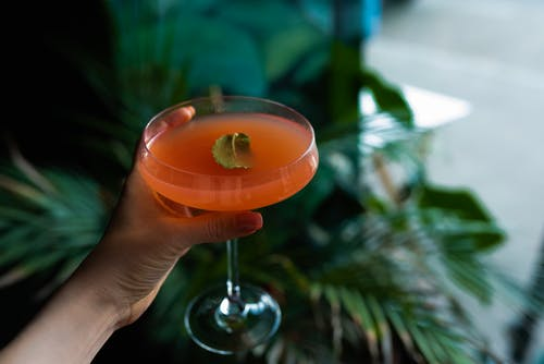 Close-Up Shot of a Person Holding a Cocktail Drink