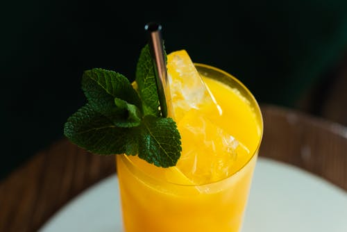 Close-Up Shot of a Cocktail Drink with Mint Leaves on a Glass