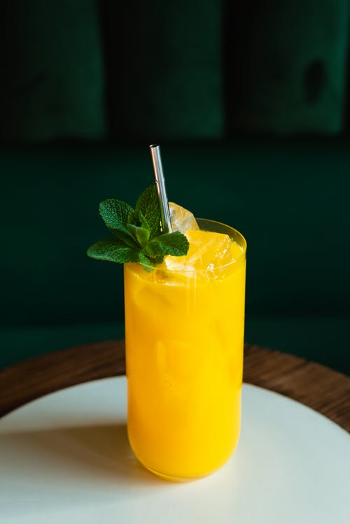 Close-Up Shot of a Cocktail Drink with Mint Leaves