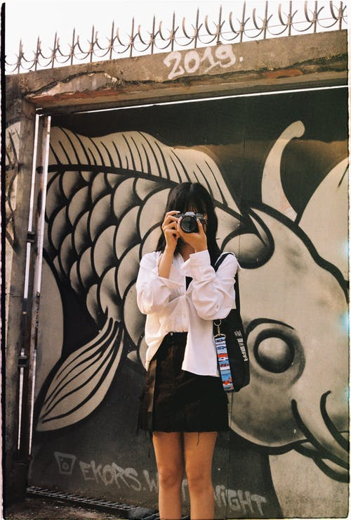 Woman Taking Pictures on the Street