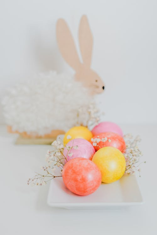Yellow and Pink Egg on White Fur Textile