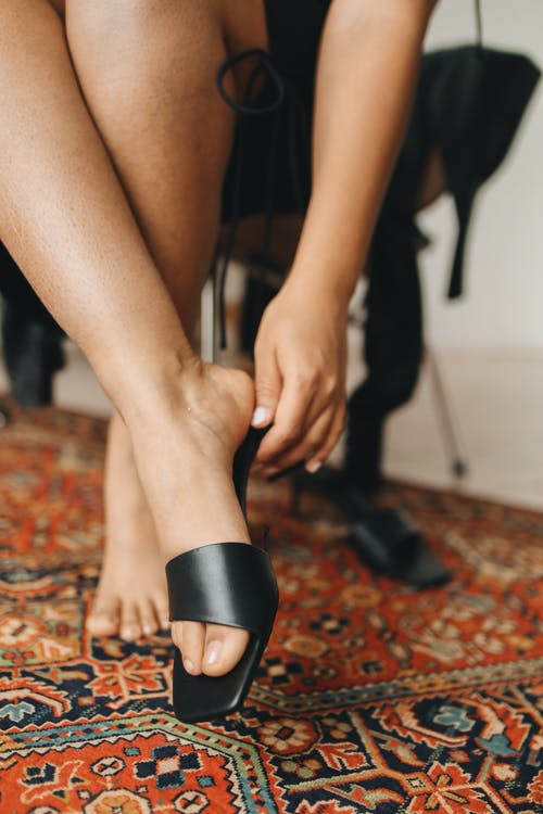 Person Wearing Black Heeled Sandals