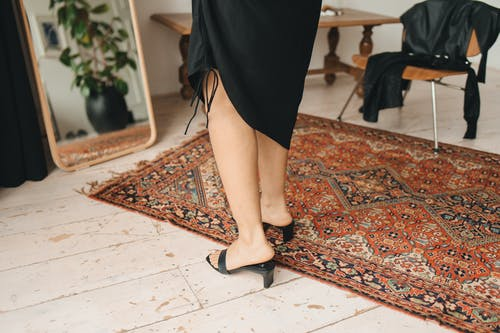 Woman in Black Skirt and Black Heels