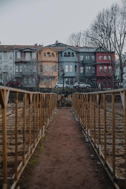 Narrow pathway between metal fences