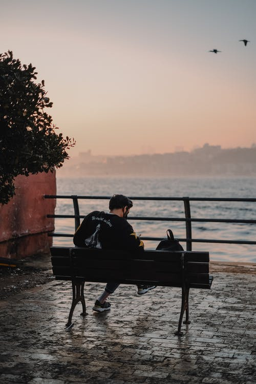 A Man Sitting on the Bench with a Scenic View
