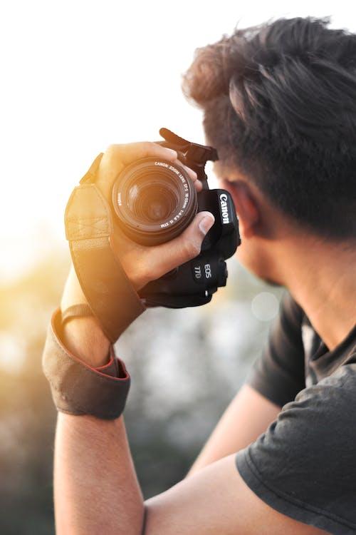 A Photographer Holding a Camera