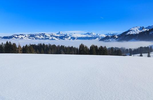 Snowy Mountain Under Blue Sky
