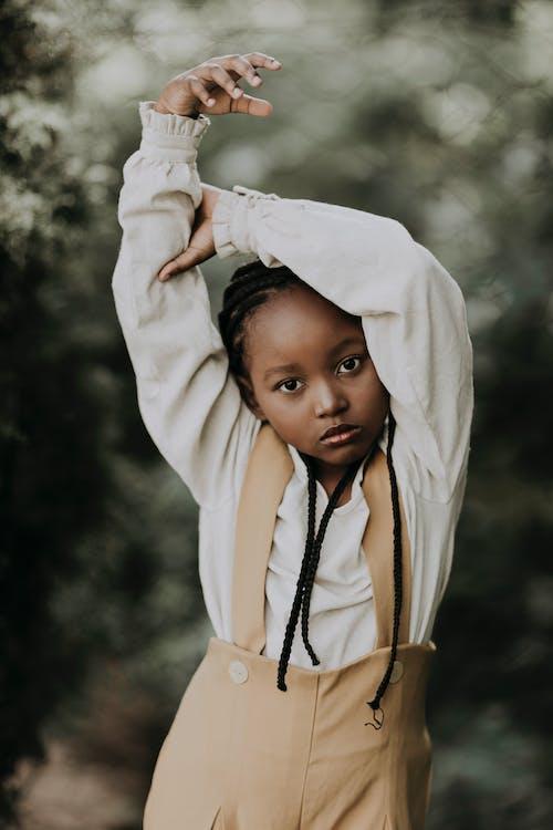 Stylish black girl in nature