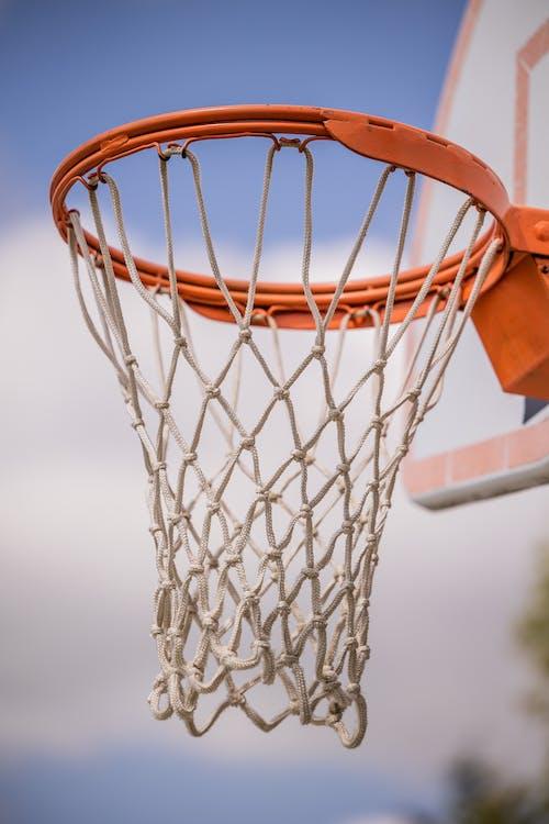 Basketball hoop on court in sunlight