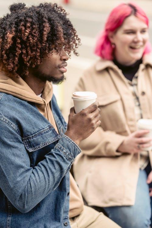 Black guy enjoying coffee near girlfriend