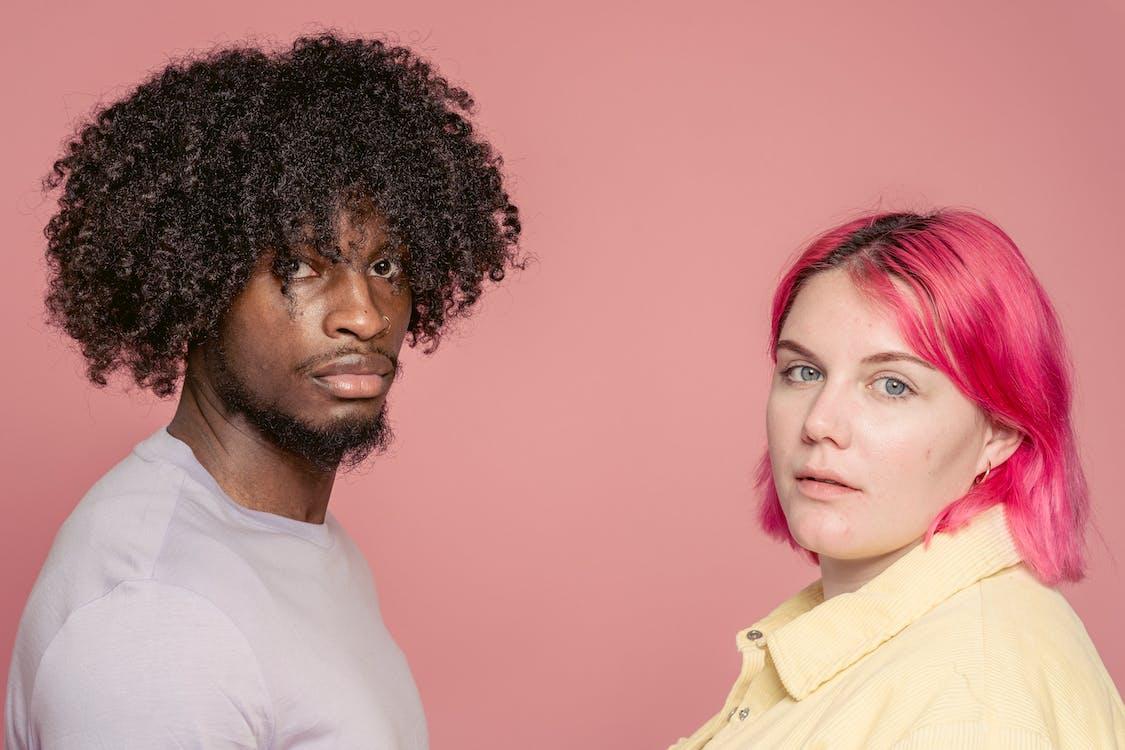 Diverse couple standing in studio