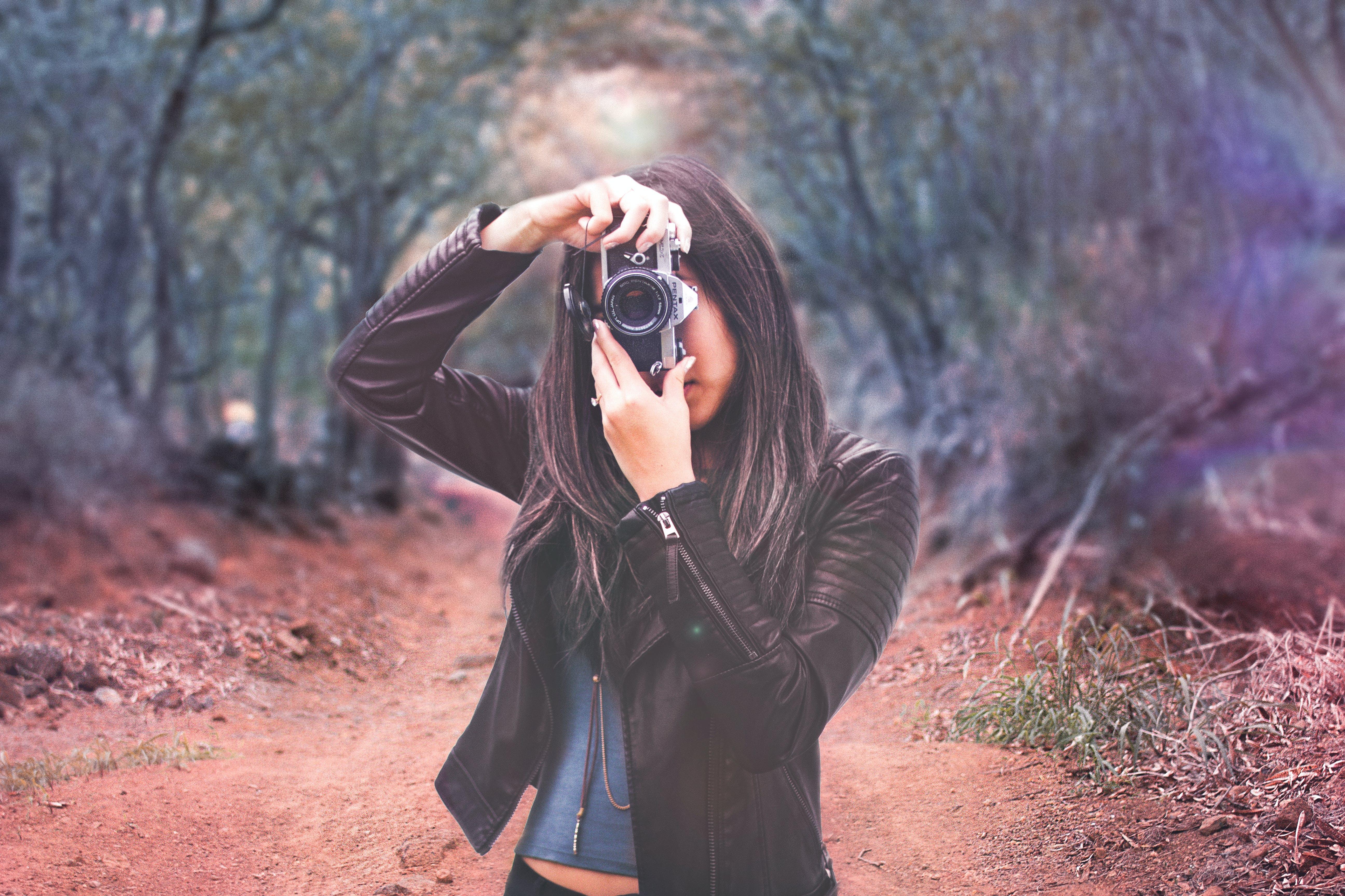 Woman Wearing Black Leather Jacket Holding Camera