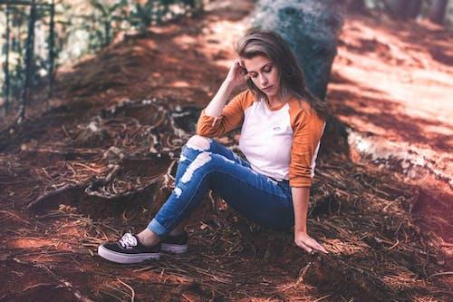 Woman Sitting On Ground