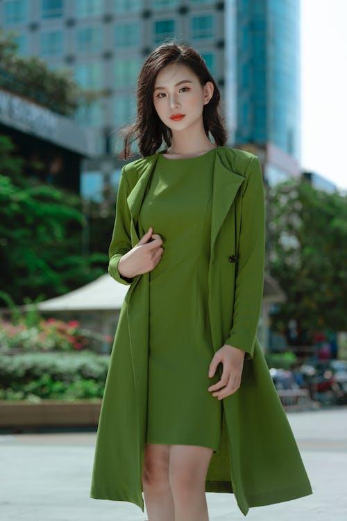 Woman in Green Long Sleeve Dress Standing