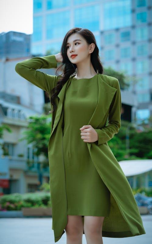 Woman in Green Long Sleeve Dress