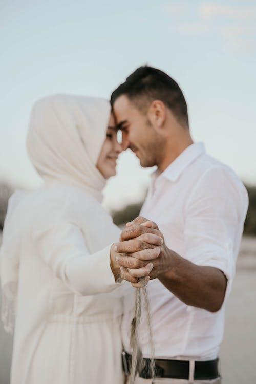 Romantic Muslim couple dancing in nature