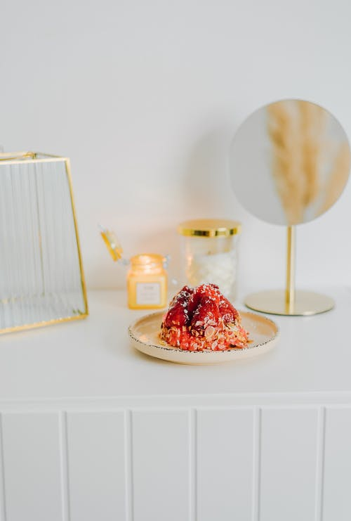White and Gold Cake Stand on White Table
